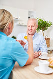 Nursing service and assistance for senior man. Nursing service and assistance for senior men with dementia stock photo