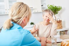 Nursing service at home for senior woman. Nursing service at home for senior women with dementia Stock Photography