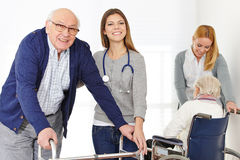 Nursing service for senior couple. Nursing service with two women for senior couple at home Stock Photo