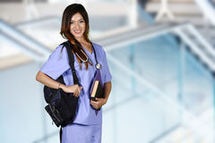 Nursing Student. Minority nursing student with her books going to class stock images