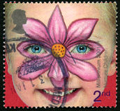 Nurture Children UK Postage Stamp. GREAT BRITAIN - CIRCA 2001: A used postage stamp from the UK, promoting the Nurturing of Children, circa 2001 stock photo