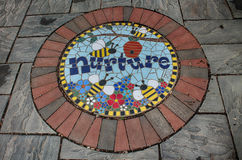 Nurture. A Stepping stone in the storybook gardens royalty free stock photo