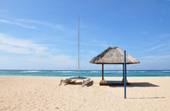 Nusa Dua Beach. Boat and hut on the empty Nusa Dua beach, Bali, Indonesia Royalty Free Stock Images