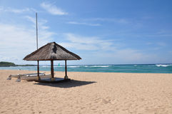 Nusa Dua Beach. Boat and hut on the empty Nusa Dua beach, Bali, Indonesia Stock Photo