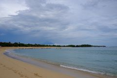 Nusa Dua beach in december, Bali. Cloudy sky and calm ocean Royalty Free Stock Images