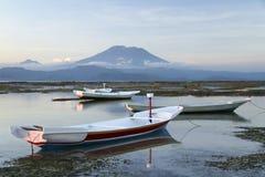 Nusa lembongan boats bali volcano indonesia Stock Photo