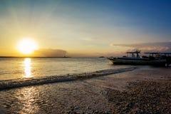 Nusa penida, Bali beach with dramatic sky and sunset Stock Photo