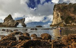 Local Fishermen throwing net to catch fish in Atuh beach when the tide was low in Nusa Penida, Indonesia