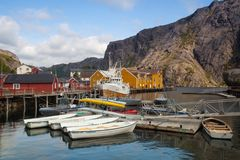 Red Classic Norwegian Rorbu fishing huts, Nusfjord on Lofoten is. Nusfjord, Norway - August 21,2017: Red Classic Norwegian Rorbu fishing huts, Nusfjord on stock photos