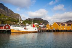 Red Classic Norwegian Rorbu fishing huts, Nusfjord on Lofoten is. Nusfjord, Norway - August 21,2017: Red Classic Norwegian Rorbu fishing huts, Nusfjord on royalty free stock image