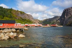 Red Classic Norwegian Rorbu fishing huts, Nusfjord on Lofoten is. Nusfjord, Norway - August 21,2017: Red Classic Norwegian Rorbu fishing huts, Nusfjord on royalty free stock photos