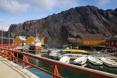 Red Classic Norwegian Rorbu fishing huts, Nusfjord on Lofoten is. Nusfjord, Norway - August 21,2017: Red Classic Norwegian Rorbu fishing huts, Nusfjord on stock photo