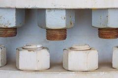 Nuss und Bolzen auf der Maschine, Bolzen ist Ausrüstung der Maschine oder der Ausrüstung Lizenzfreie Stockbilder