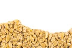 Nuss-und-Honigstange auf Weiß Stockbild
