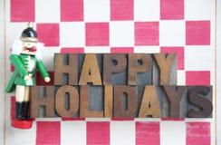 Nussknackerschachbrett frohe Feiertage Stockfotos