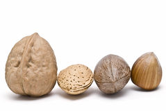 Nut, almond, nut and hazelnut. Some nuts isolated on a white background Stock Images