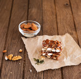 Nut bar with nuts. On wooden table Stock Photo