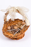 Nut basket. A basket of various nuts stock photo