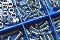 Nut and bolt. In blue box stock images