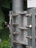 Nut and bolt. Hard chrome nut and bolt set on Thai lamppost stock photo