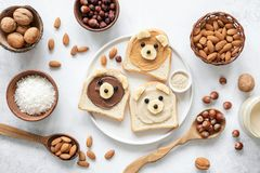 Nut butter banana toast for kids with animal face. Food art, healthy kids meal. Table top view. Healthy eating, healthy lifestyle, kids meal, kids menu royalty free stock image