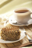 Nut cake. Light still life: cup of tea and nut cake Stock Photos
