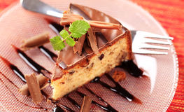Nut cake with chocolate icing Stock Photography
