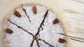 Nut cake cut into pieces stock video