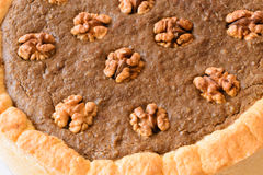Nut cake. Detail of delicious nut cake. Close up  on white background Stock Image
