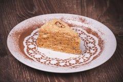 Nut cake slice with honey Stock Photography
