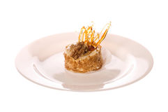 Nut cake on the white plate Royalty Free Stock Photography