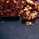 Nut Chocolate bar background/ Dark crushed chocolate with copy s Royalty Free Stock Images