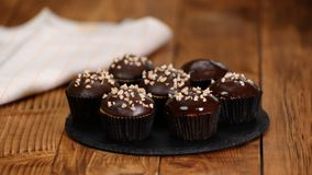 Nut-chocolate muffins covered with dark chocolate and nuts.  stock video footage