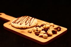 Nut cookies and hazelnuts on a wooden board stock images