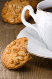 Nut cookies and white cup Royalty Free Stock Photo