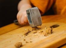 Nut crack of metal hammer Stock Image