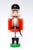 Nut Cracker. Christmas nutcracker doll on a white background Royalty Free Stock Photography