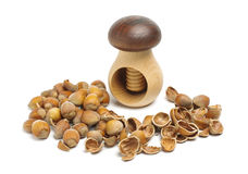 Nut cracker between hazelnuts Stock Image