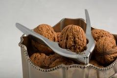 Nut cracker in pot full of walnuts Stock Photos