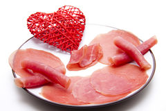 Nut ham with heart on plate Stock Images