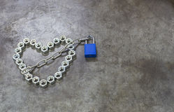 The nut heart with blue key on the metal background. The nut hea Stock Image