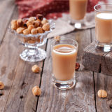 Nut liqueur. Italian traditional liqueur with nuts, square image Stock Image