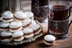 Nut macaroons served with coffee Stock Photos