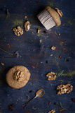 Nut mini cakes wil walnuts on rusty wooden table. Top view. Royalty Free Stock Image