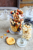 Nut mix in glass jars Stock Images