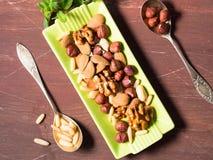 Nut mix on green dish Royalty Free Stock Photo