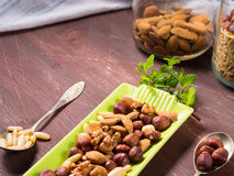 Nut mix on green dish Royalty Free Stock Images