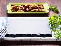 Nut mix on green dish Royalty Free Stock Photos