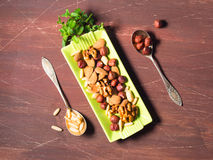 Nut mix on green dish Royalty Free Stock Image