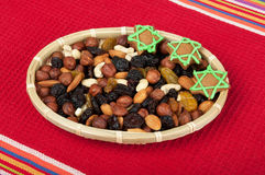 Nut mix in a small basket. On a red towel royalty free stock photography